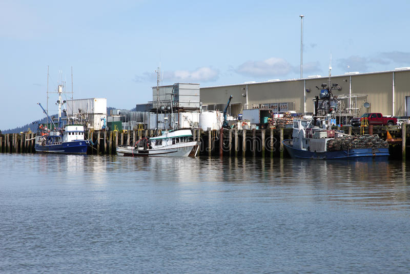 Port of Astoria, Oregon. Fishing boats unloading at the port of Astoria Oregon stock photography