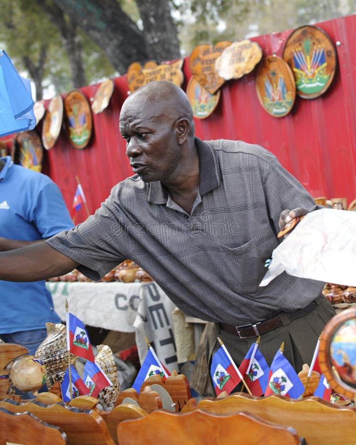 PORT AU PRINCE, HAITI - FEBRUARY 11, 2014. A Haitian souvenir. A Haitian man selling souvenirs in Port Au Prince, Haiti stock photography