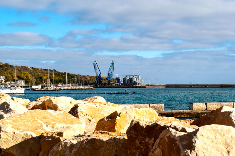 Port Balchik. View to the unloading of ships arriving at the port of Balchik in Bulgaria stock image