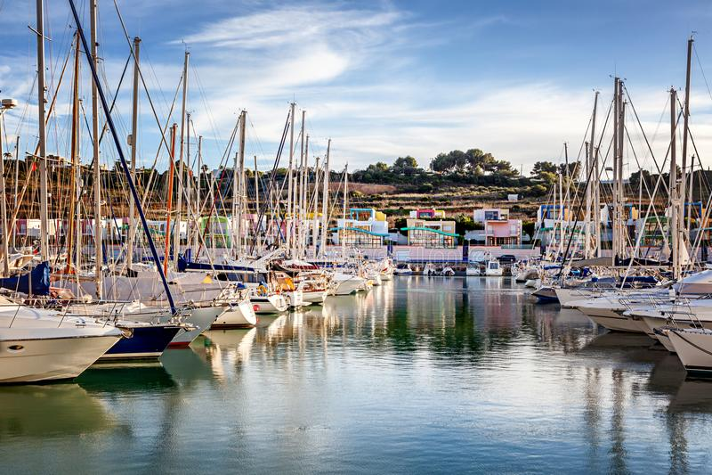 Port in the bay of Albufeira, Portugal, many boats and yachts in. The background of the city, a popular destination for travel and recreation in Europe stock image