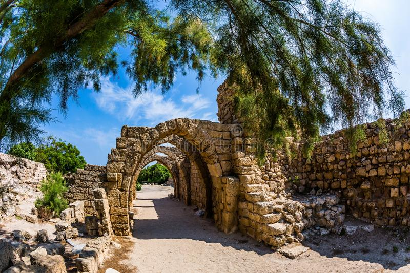The Port of Caesarea. Sunny spring day. Israel. Concept of ecological and historical tourism. Arched passage - covered street of Port of Caesarea. Excursion to royalty free stock images