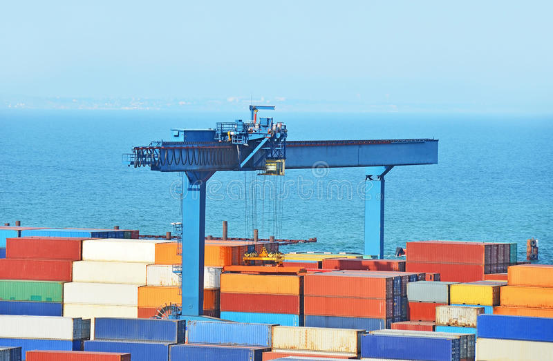 Port cargo crane. And container over blue sky background stock images