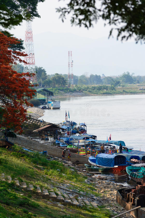 Port of Chiang Sean and migrant Burmese worker. CHIANGRAI,THAILAND - MAY 17 : Port of Chiang saen located in border of Thailand and Lao,full with transportation royalty free stock photography