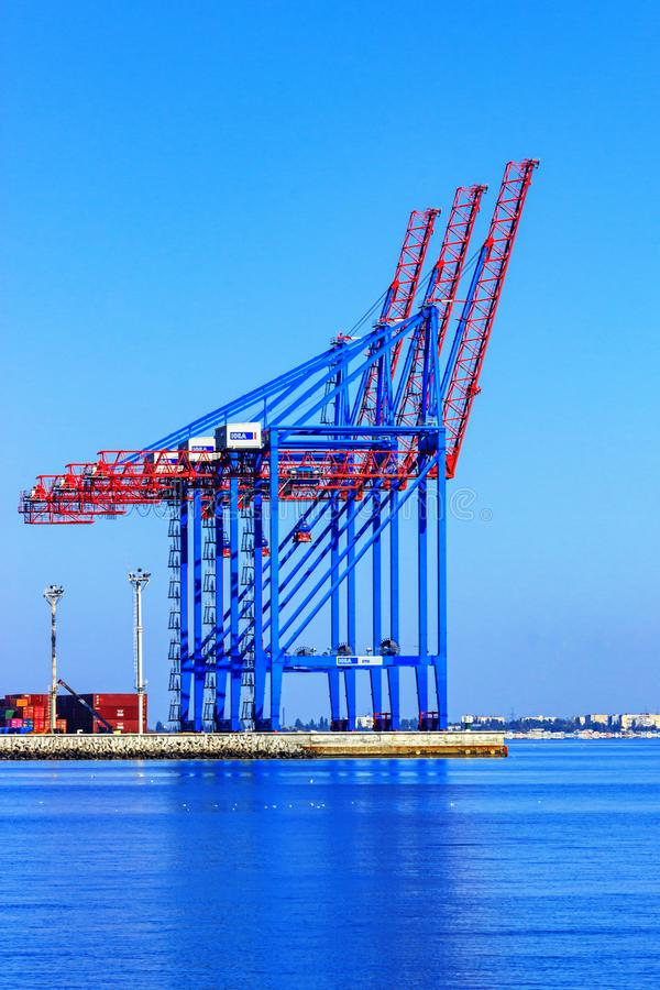 Port cranes against the sky royalty free stock image