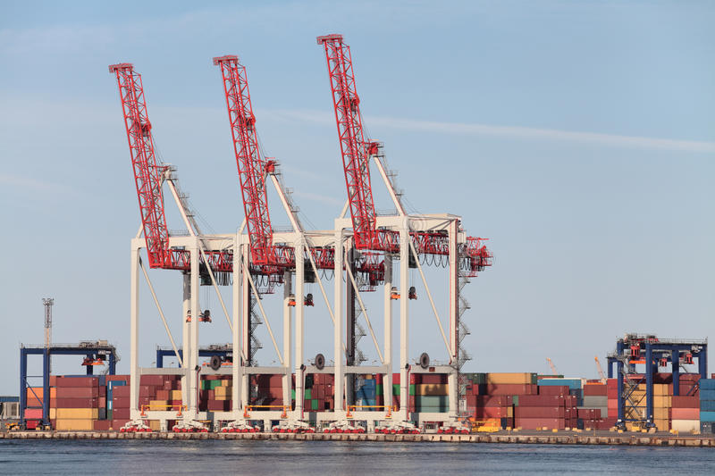 Port. Cranes in the seaport, storage containers royalty free stock images