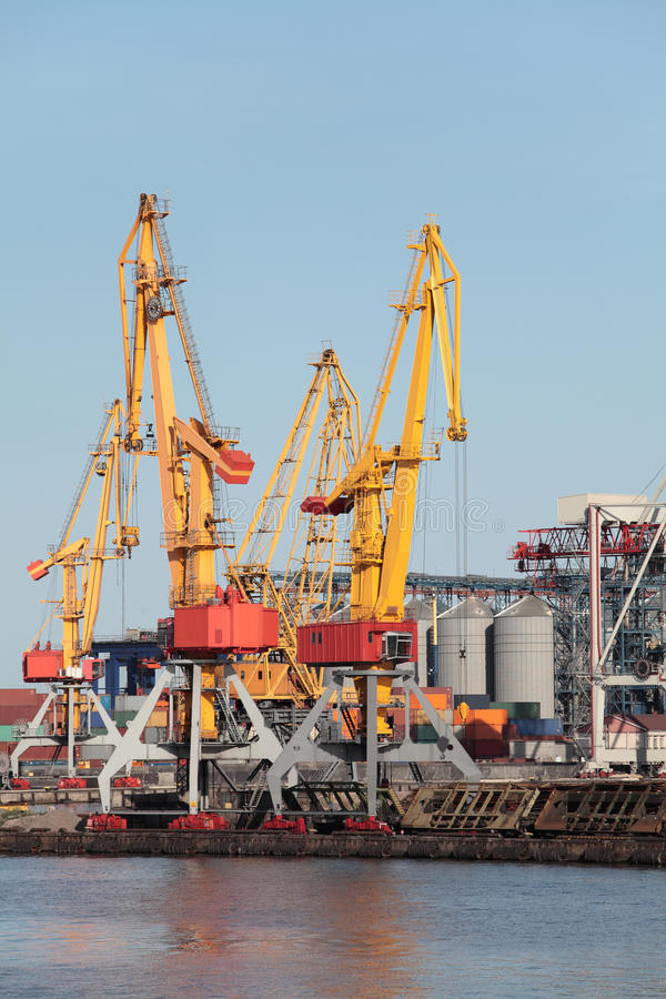 Port. Cranes in the seaport, storage containers royalty free stock photography