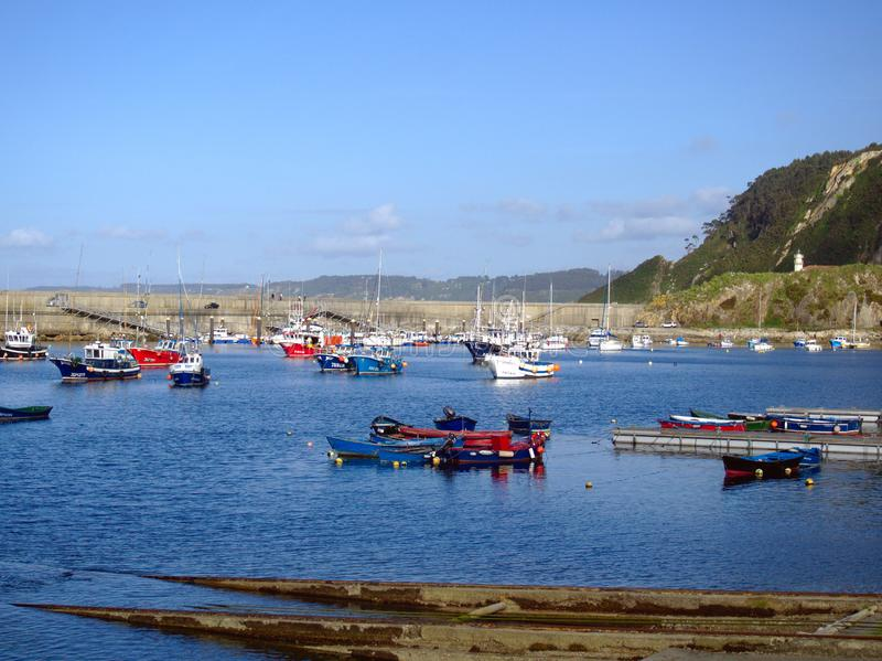 Port of Cudillero with its lighthouse in the background royalty free stock images