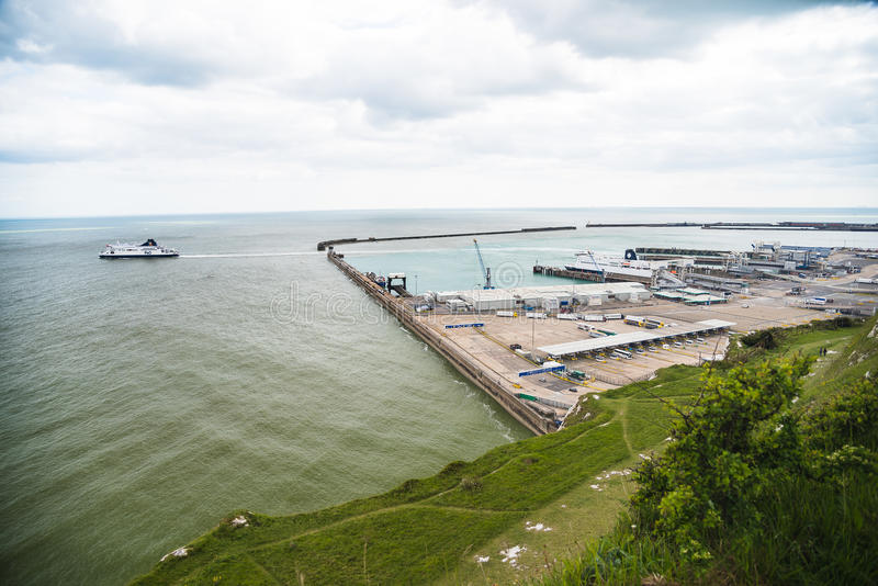 Port of Dover. View of the Port of Dover from the cliffs with trucks / lorries loading on the ferry in a cloudy day with a ferry departing - Kent UK (05/2016 royalty free stock photography