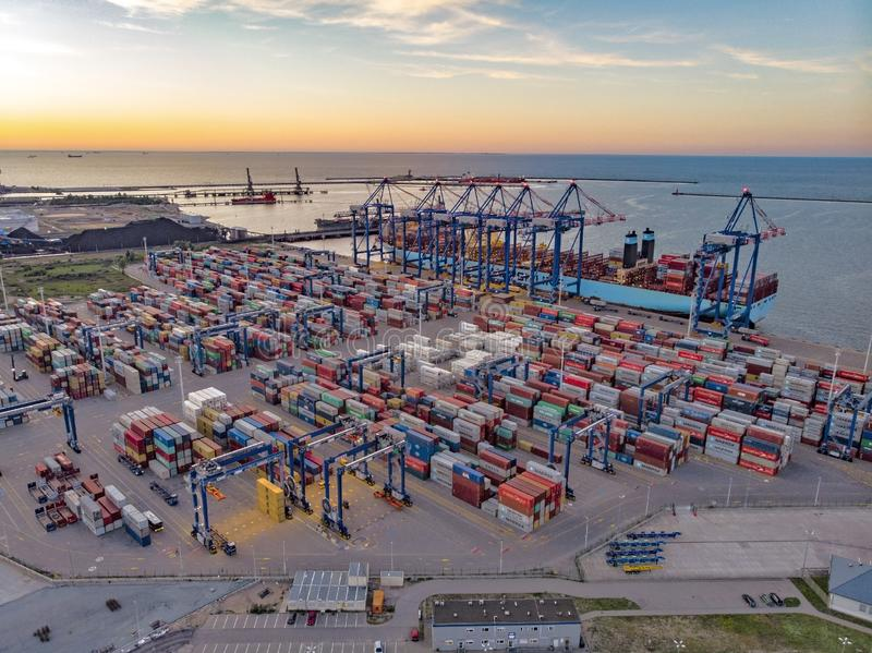 Port at evening. Portgdansk, export, import, transport, transportation, load, unload, containers, cargo, sunset, containership, dctgdansk, industry stock photos