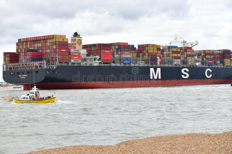 Container ship flows from Felixstowe UK. The Port of Felixstowe is Britain's biggest and busiest container port, and one of the largest in Europe royalty free stock images