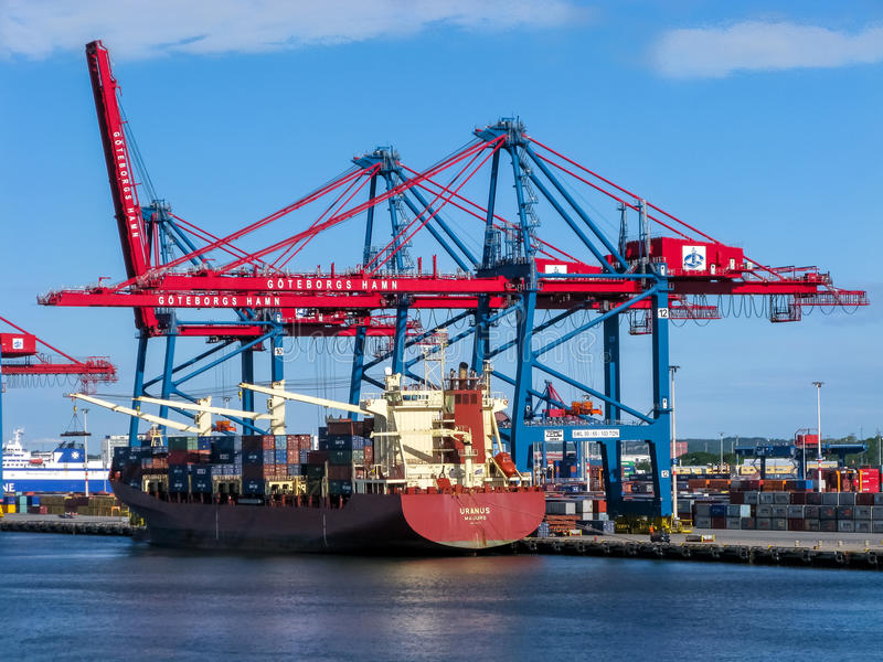 Port of Gothenburg, Sweden. Container ship at container terminal in port of Gothenburg, Sweden stock photo