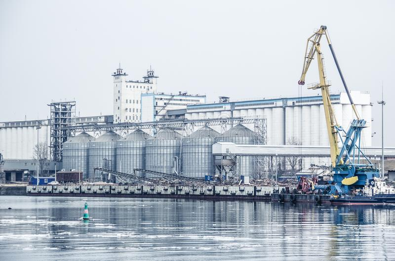 Port grain elevator. The Don river and the port. Industrial zone. Russia, Rostov-on-Don. royalty free stock images