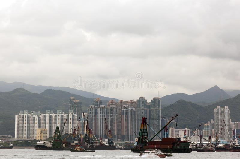 A port of Hong Kong China and shipping containers, buildings and the sea.  stock photo