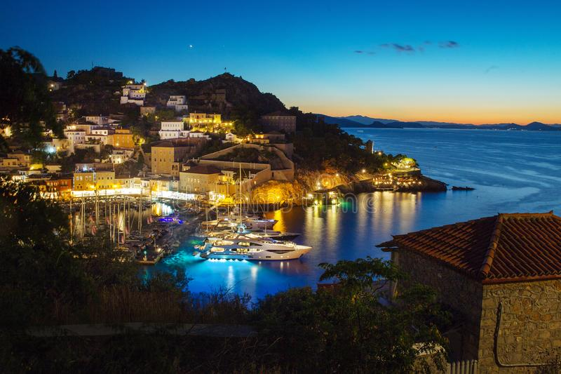 Port at Hydra island. Harbor at Hydra greek nisland at evening time- sun fall. Original and lovely island Hydra - town on hills stock image