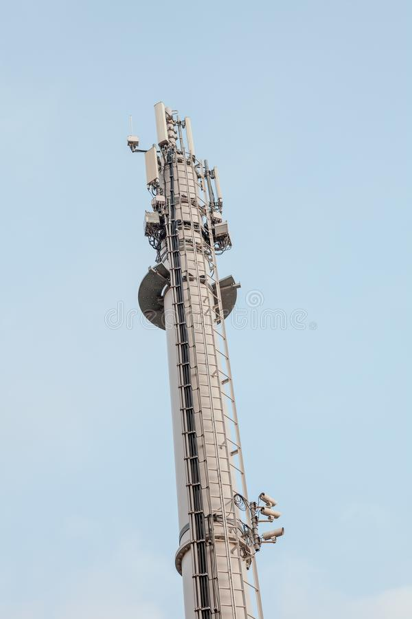 Cell phone tower. In the port of an industry there is a mobile phone mast royalty free stock photography
