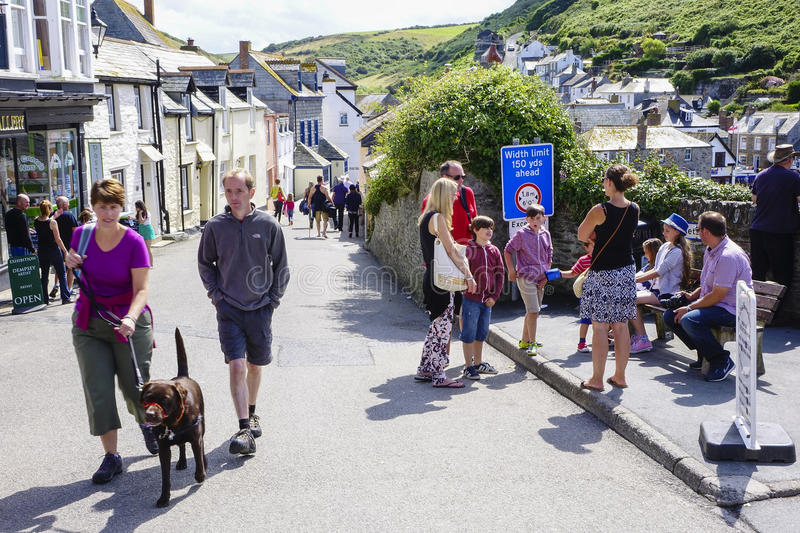 Port Issac hot sunny summers afternoon walking in the sun. Port Issac hot sunny summers afternoon in August with holidaymakers enjoying walking in the sun stock photo