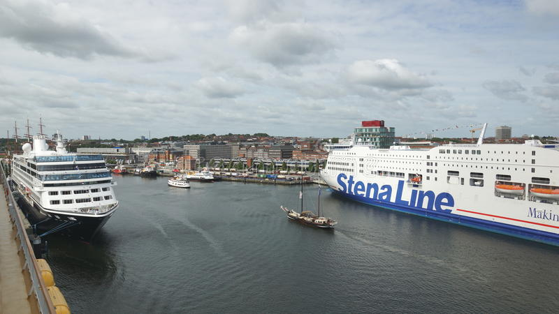 Port of Kiel - Stena Line - Azamara Quest. Two beautiful large ferries and many smaller ships located in port of Kiel. Stena Line and Azamara Quest. Kiel is the stock photo