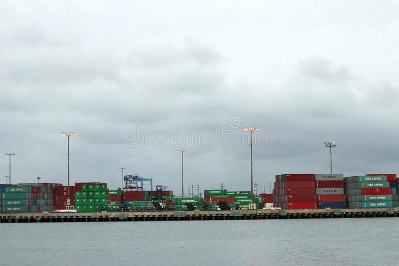Port of Los Angeles Containers. LOS ANGELES, UNITED STATES - Mar 13, 2014: Stacked containers at Port of Los Angeles on a cloudy day stock photo