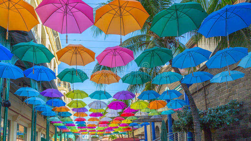 Port louis le caudan waterfront umbrellas capital of Mauritius.  royalty free stock images
