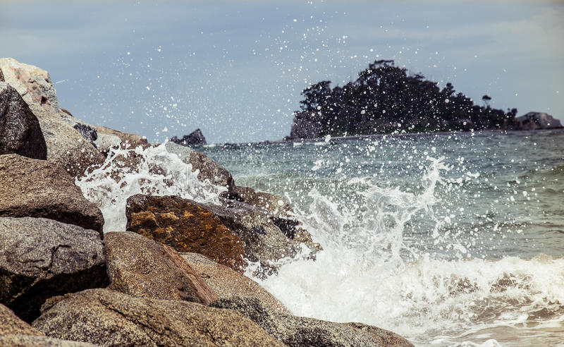 Port Macquarie. Waves crashing on rocks, nature, ocean, power, vacation. A close up view of ocean waves crashing into the rocks. crash coast tidal spray shore stock images