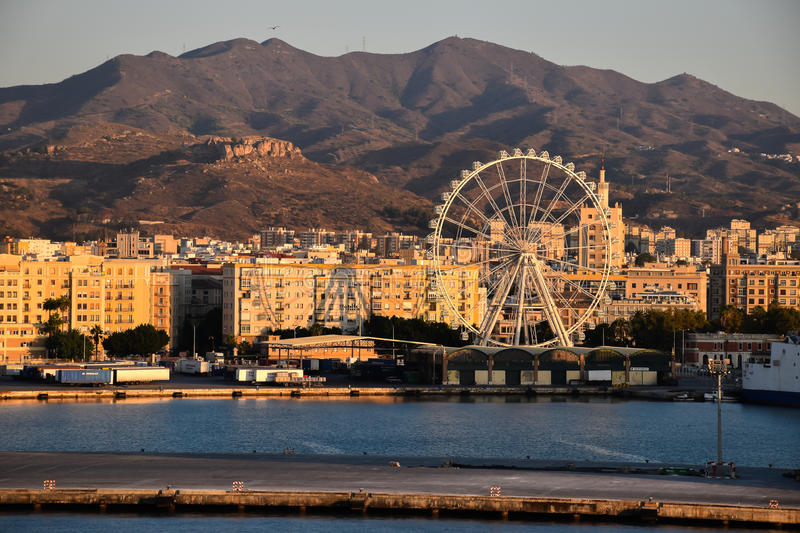 Port of Malaga, Spain. Sunrise cityscape with ferris wheel. View of the waterfront of the port of Malaga, Spain stock image