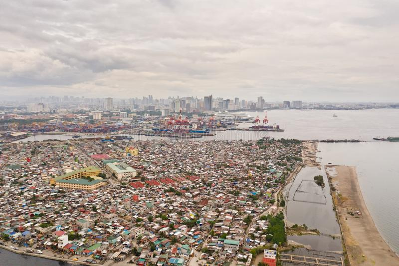 Port in Manila, Philippines. Sea port with cargo cranes. Cityscape with poor areas and business center in the distance, view from. Above. Asian metropolis royalty free stock images