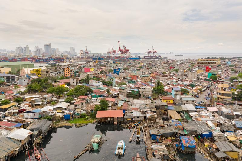 Port in Manila, Philippines. Sea port with cargo cranes. Cityscape with poor areas and business center in the distance, view from. Above. Asian metropolis stock photo