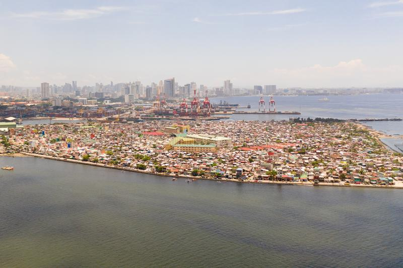 Port in Manila, Philippines. Sea port with cargo cranes. Cityscape with poor areas and business center in the distance. View from above. Asian metropolis stock images
