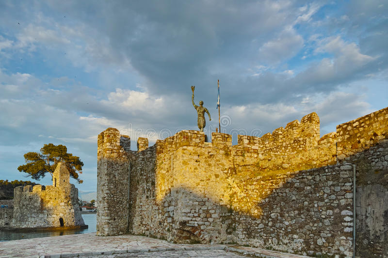 The port of Nafpaktos town and monument over Castle wall, Greece. The port of Nafpaktos town and monument over Castle wall, Western Greece royalty free stock photography