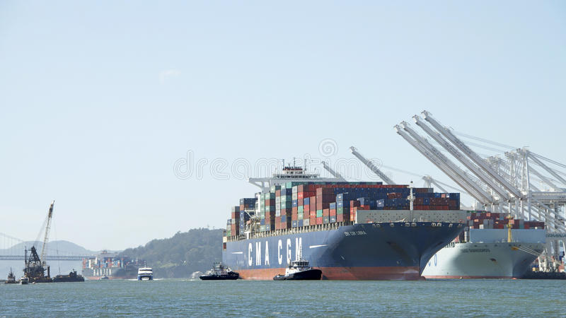The Port of Oakland, the fifth busiest container port in the US. Oakland, CA - March 28, 2016: Cargo Ship CMA CGM LIBRA arriving at the Port of Oakland, the 5th royalty free stock photo