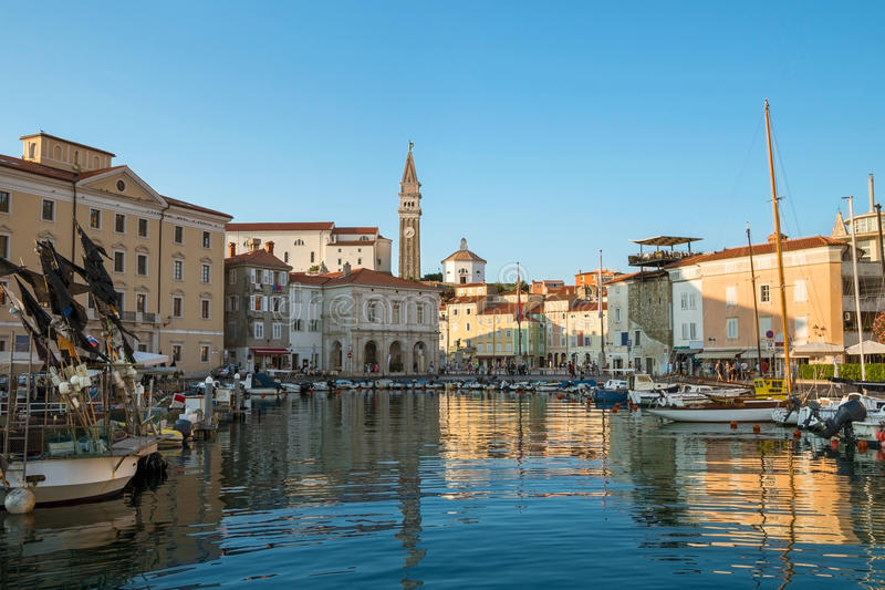 Port of Piran with boats and Church of St. George in background, Slovenia royalty free stock photo