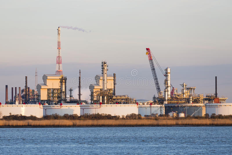 Port Refinery Oil Tanks In Evening Sunlight royalty free stock photo