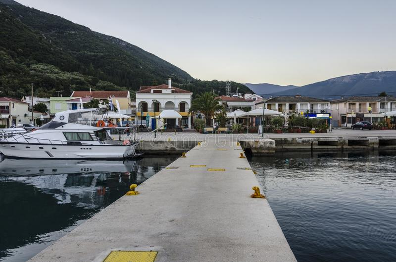 View from a dock of Sami harbor on the island Kefalonia Greece. Port of Sami one of its docks then the port facilities and finally the hills of the island of stock images
