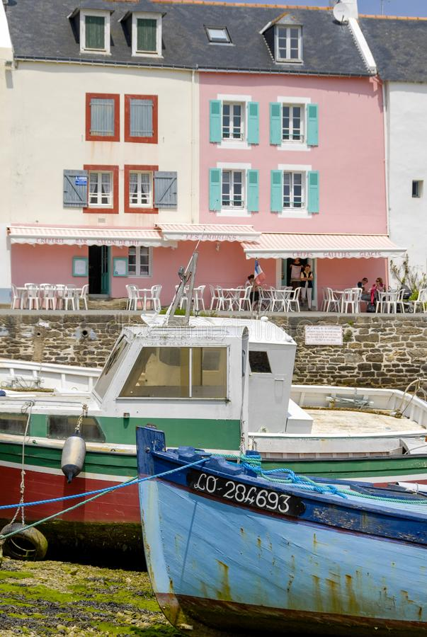 The port of Sauzon in Belle-Ile-en-Mer. Colorful houses and boats stranded in the port of Sauzon, at low tide, Belle-Ile, Brittany royalty free stock photography