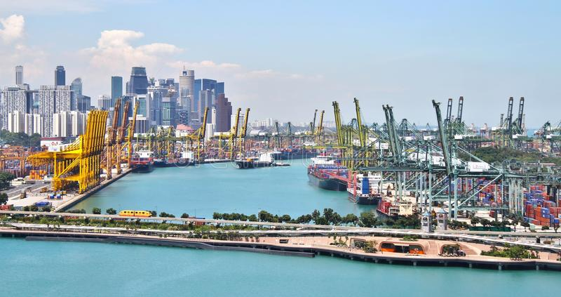 Port of Singapore. Landscape photograph of the Port of Singapore from Vivocity with a tram to Sentosa in the frame royalty free stock image