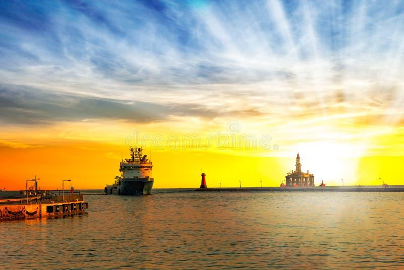 Port at sunrise. Ship return to port at sunrise stock photo