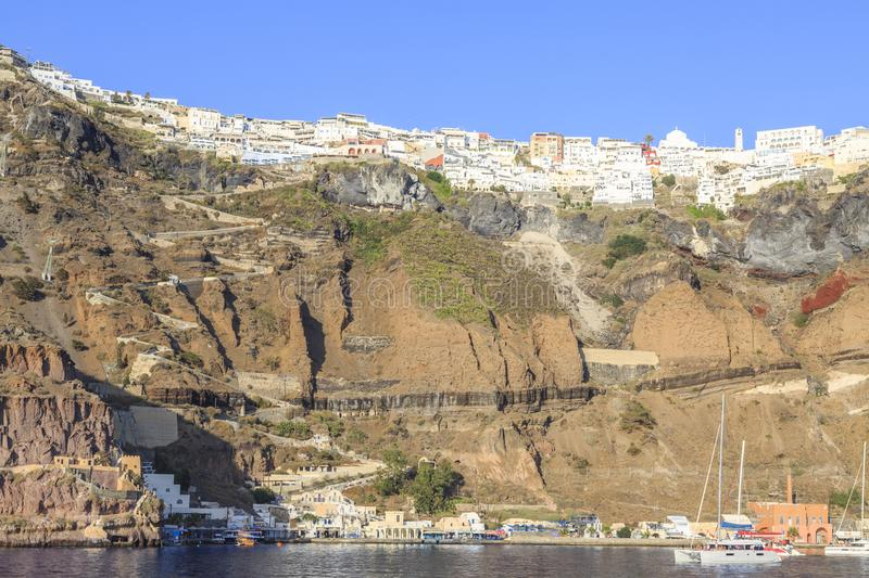 Port of Thira and Thira town together with the road from port to city and cable car royalty free stock photography