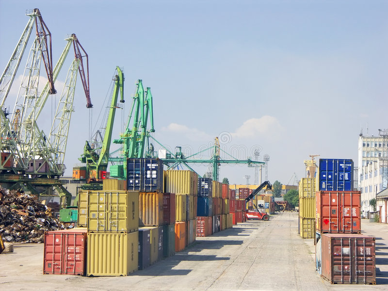 Port of transhipment. Colorful metal freight containers waiting for loading in port of transhipment stock photo