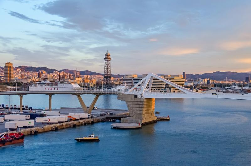 Port Vell with its bridge Porta d`Europa and the aerial tramway tower Torre Jaume I in Barcelona stock photo
