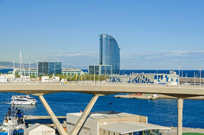 Port Vell with its cruise terminal, bridge Porta d`Europa, Nautic Center and W Barcelona royalty free stock image