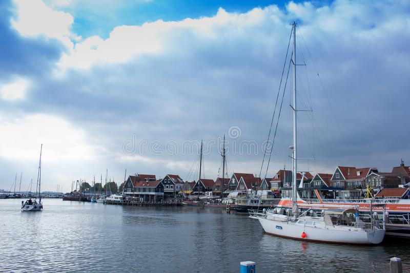 The port of Volendam, The Netherlands. Volendam is a Dutch town on the Markermeer Lake, northeast of Amsterdam. It's known for its colorful wooden houses stock photo