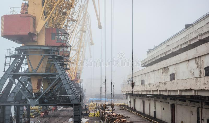 Port warehouse with ramp and cranes and other infrastructure stock images