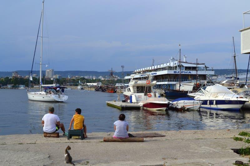 Port wharf view. People fishing on a wharf at Varna port,Bulgaria royalty free stock photo
