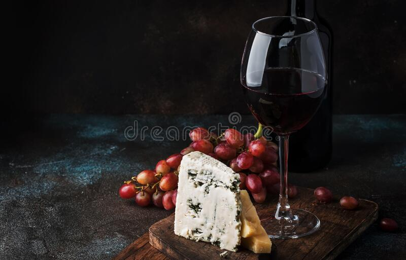 Port wine and blue cheese, still life in rustic style, vintage wooden table background, selective focus stock photos
