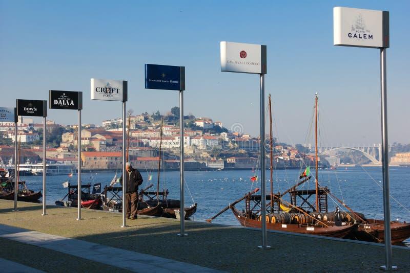 Port wine producers billboards. Porto. Portugal. Famous brands. A row of port wine producers billboards on Douro riverside in Vila Nova do Gaia. Porto. Portugal royalty free stock image