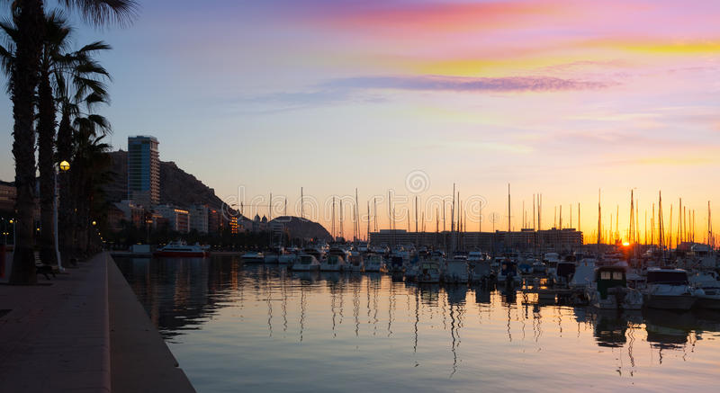 Port with yachts and embankment in sunrise. Alicante stock photo