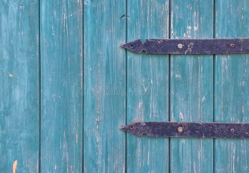 Porta azul com textura do fundo dos detalhes fotografia de stock royalty free