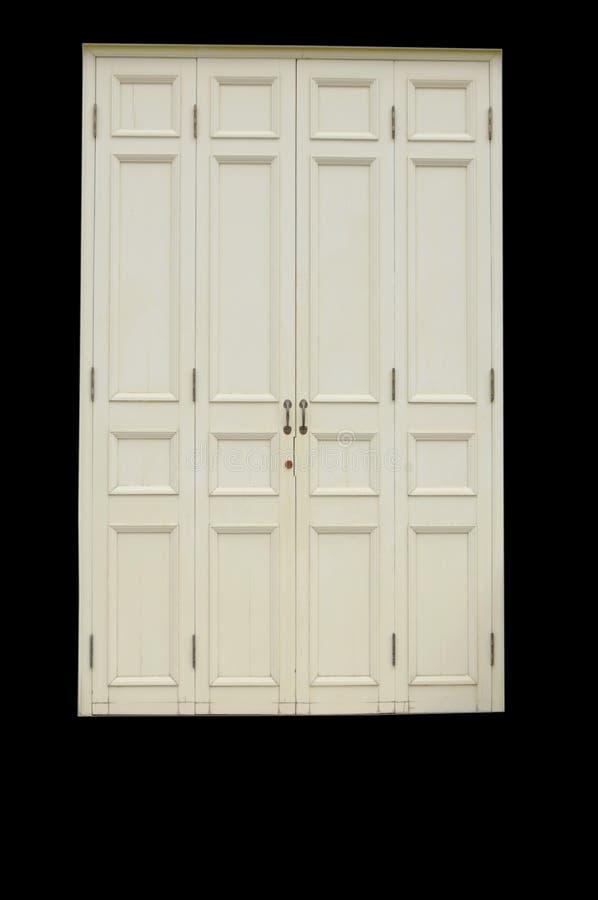 Porta branca de madeira velha e antiga isolada no fundo preto foto de stock royalty free