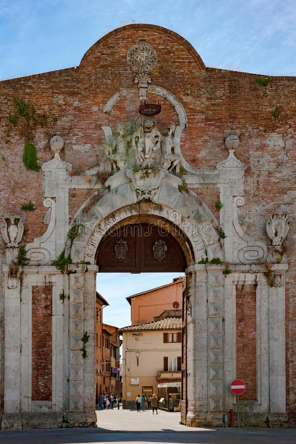 Entrance to Siena, Porta Camollia Gate with Medici heraldic shield in Siena,Tuscany, Italy. stock images