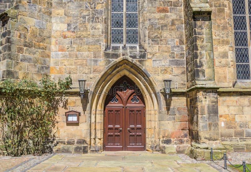 Porta da igreja reformada em Schuttorf imagem de stock royalty free